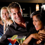 group-of-people-with-drinks-at-nightclub-bar